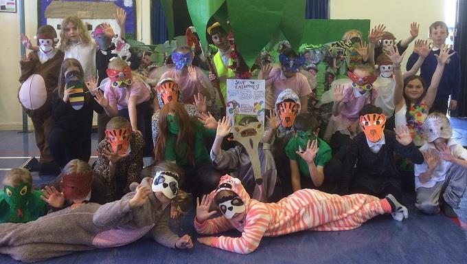 "Brisbane Primary School held a ""Jungle Fund-Ie"" a presentation about the rainforest for their families and friends. They performed a dance and songs about the rainforest and raised £430! Thanks!"